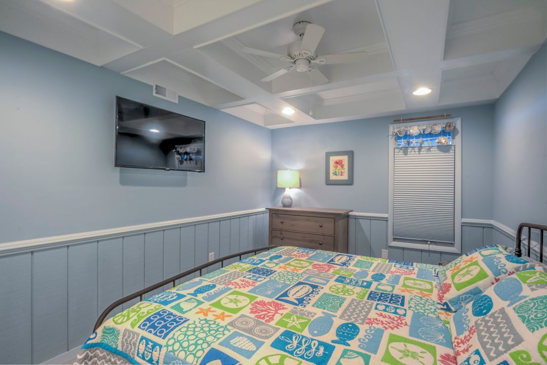 Renovation in Campbell Place, Bethany Beach DE - Bedroom with White Ceiling Fan and Sea Themed Details Above Window Blinds