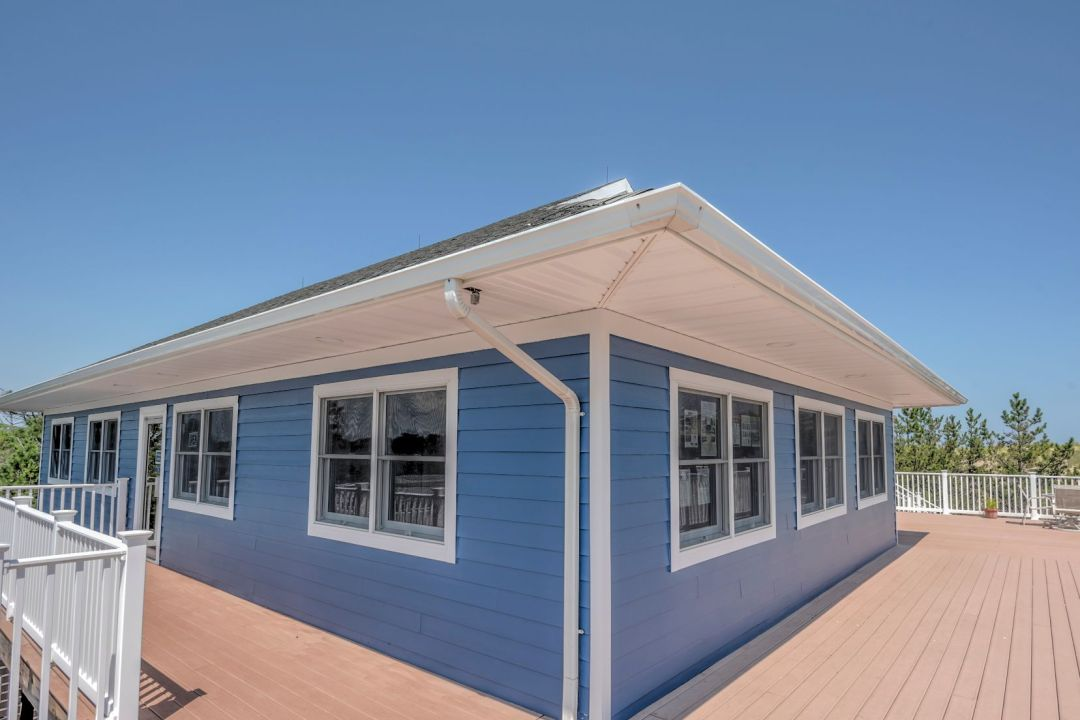 Exterior in Coastal Highway, Fenwick Island DE - Blue Siding and White Window Frames
