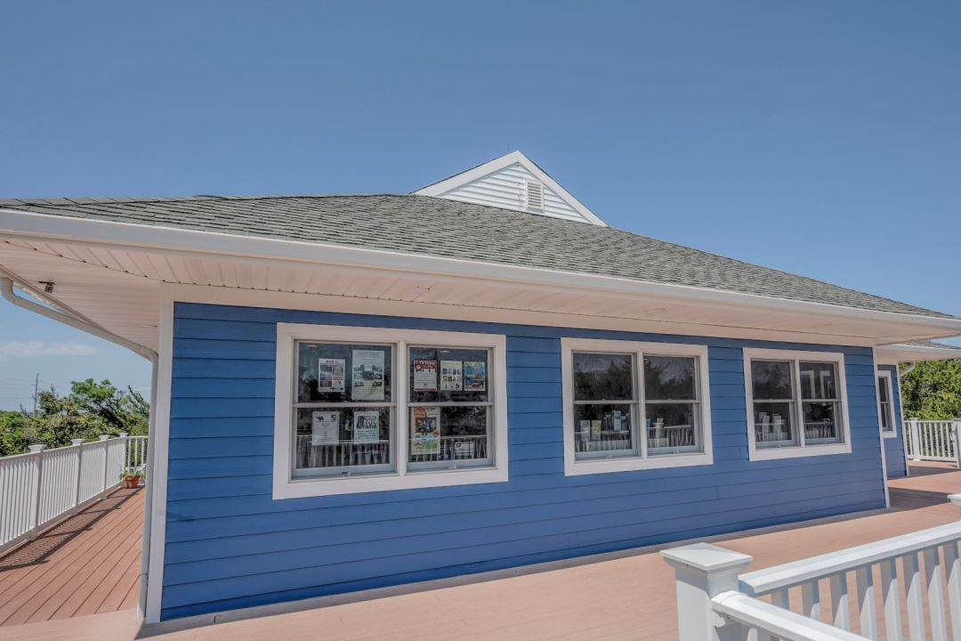 Exterior in Coastal Highway, Fenwick Island DE - Side View with Three Windows