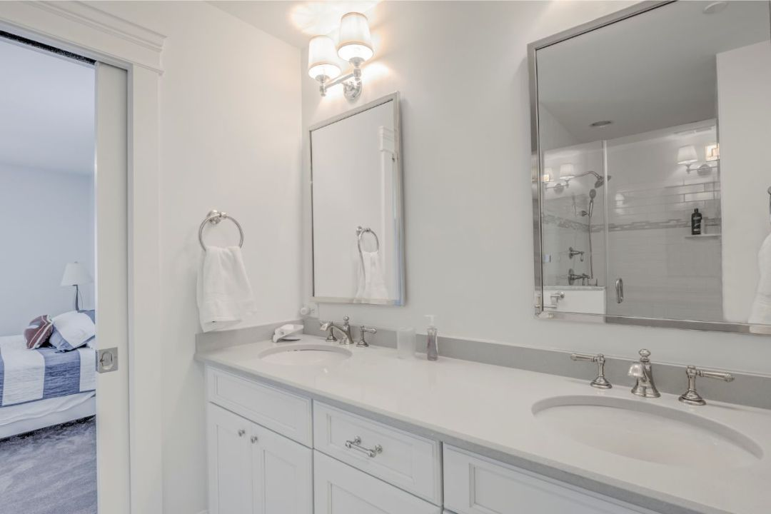 Bathroom Remodel in Dune Road, Bethany Beach DE - Master Bathroom with White Vanities, White Top and Two Mirrors
