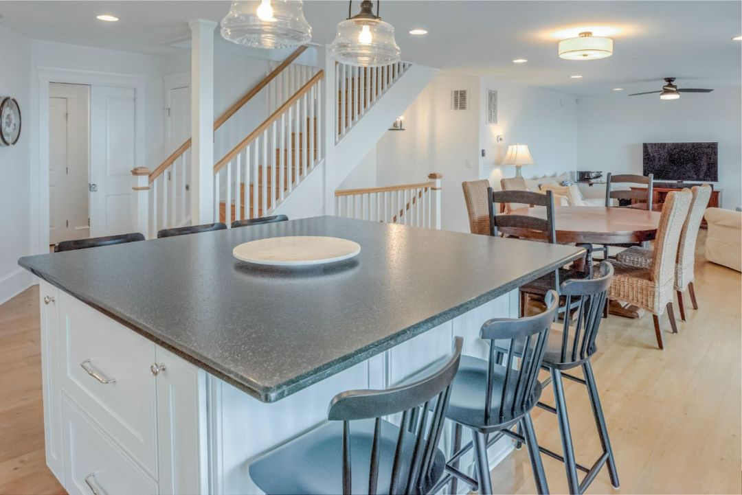 Center Island with Dark Green Granite Countertop