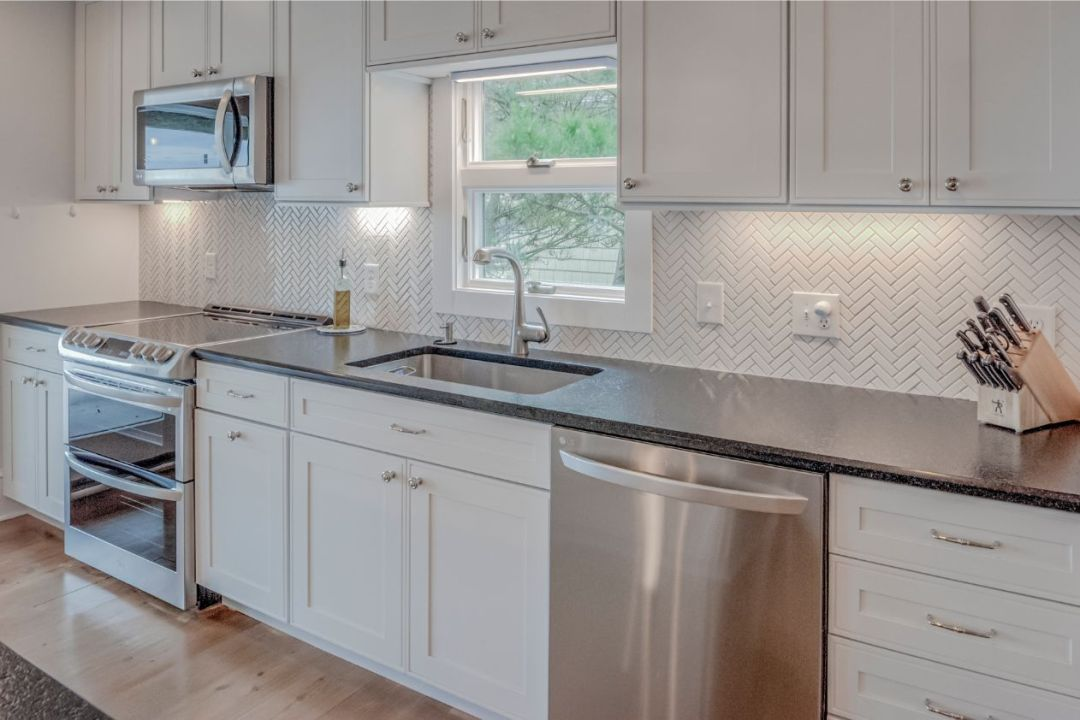 Kitchen with White Vanities and White Tiles Backsplash