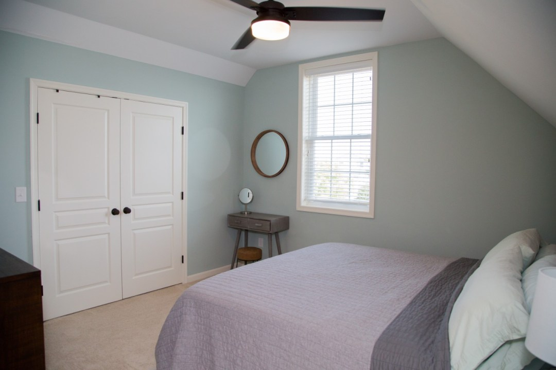Guest Bedroom with White Closet and Ceiling Fan