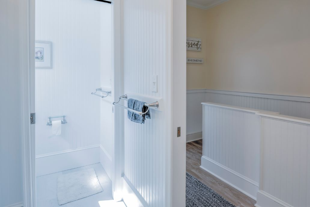 Bathroom with White Walls and Sliding Door
