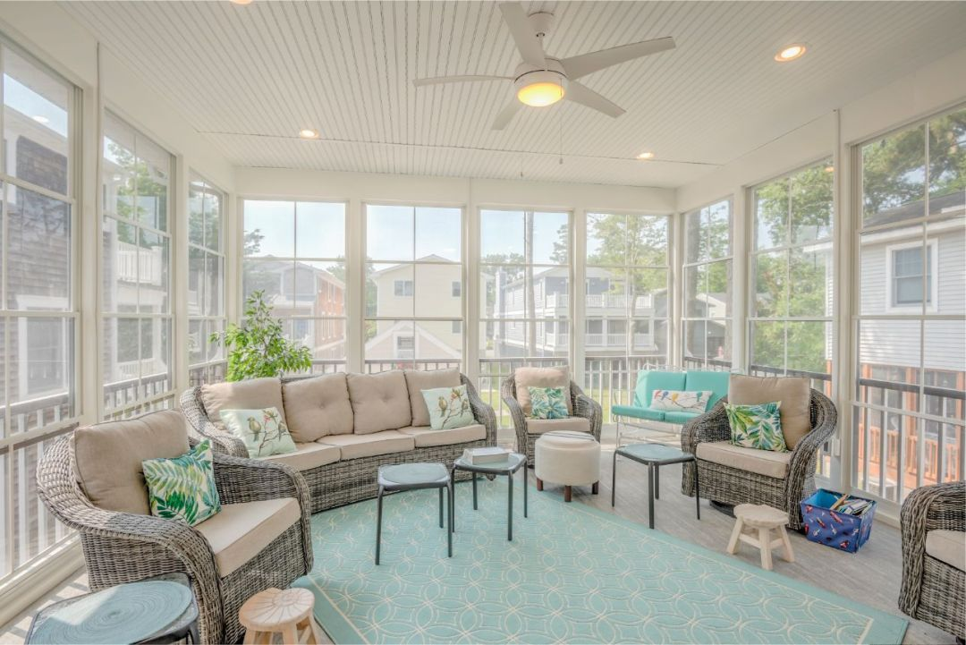 Addition in Hollywood Street, Bethany Beach DE - Sunroom with Rattan Furniture and Teal Accents