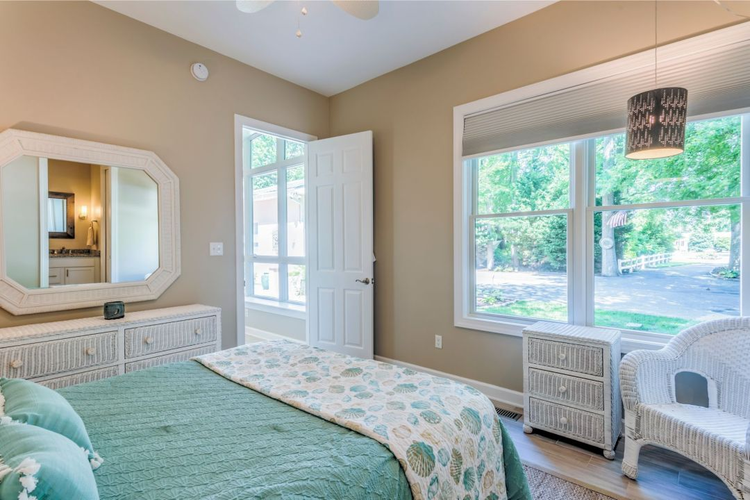 Addition in Juniper Court, Ocean Pines MD - Bedroom with Large Windows and Octagon Mirror