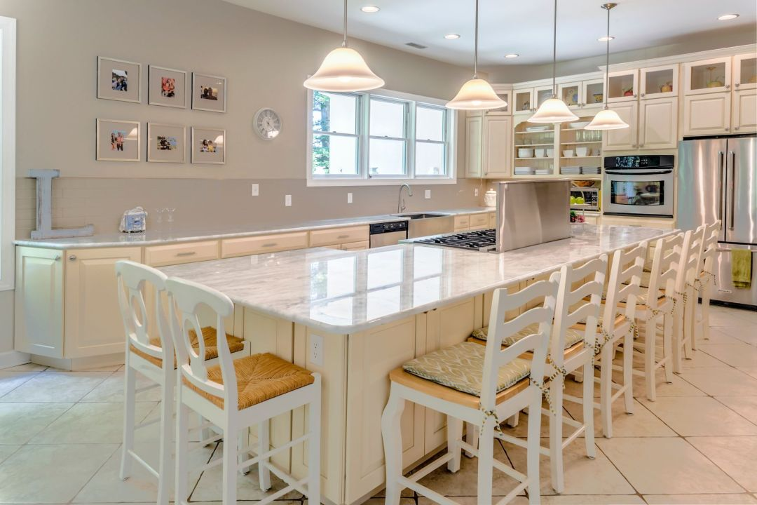 Addition in Juniper Court, Ocean Pines MD - Kitchen with Four Pendant Lights and White Chairs