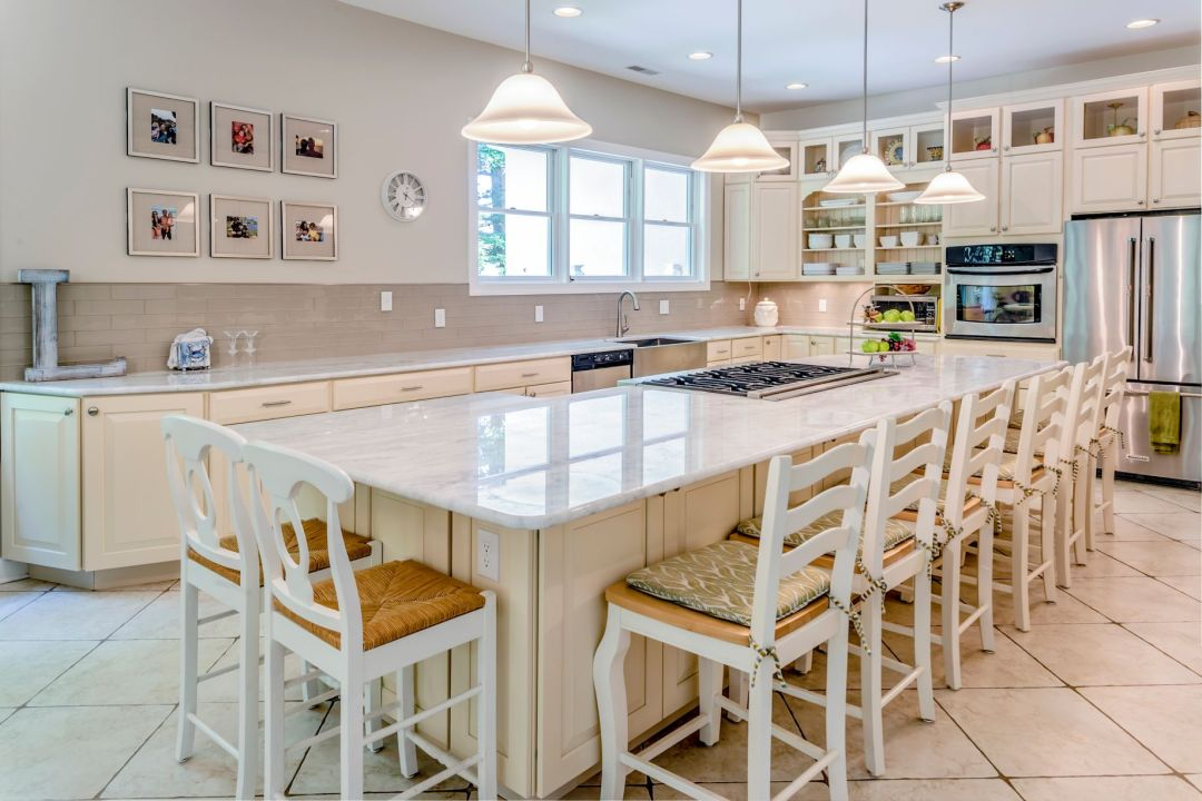 Kitchen in Juniper Court, Ocean Pines MD with Island with White Marble Countertop and White Tiles Flooring