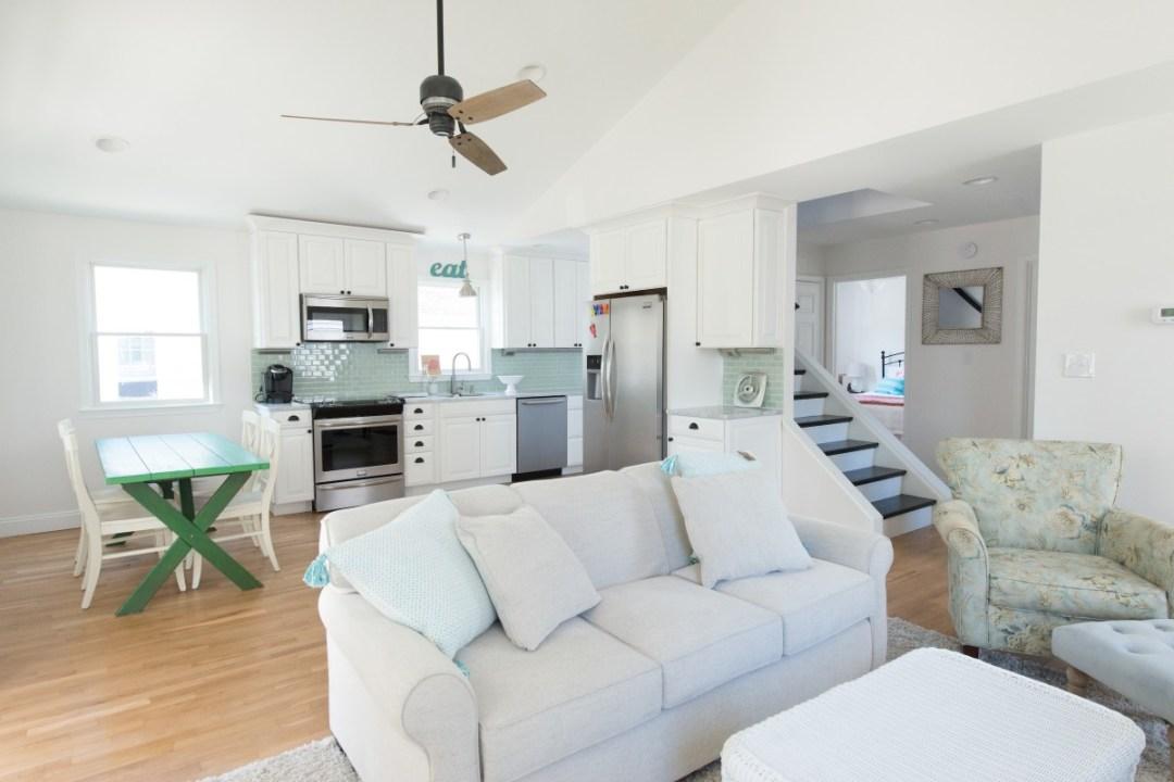 Kent Renovation Bethany Beach, DE Living Room Wood Flooring, White Walls Paint, Light Beige Fabric Sofa Recessed Can Lights
