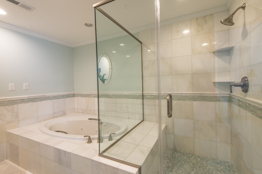 Bathroom Remodel in Kings Grant, Fenwick Island DE with Frameless Shower Door, Waterproofing System, Tub and Mosaic Floor