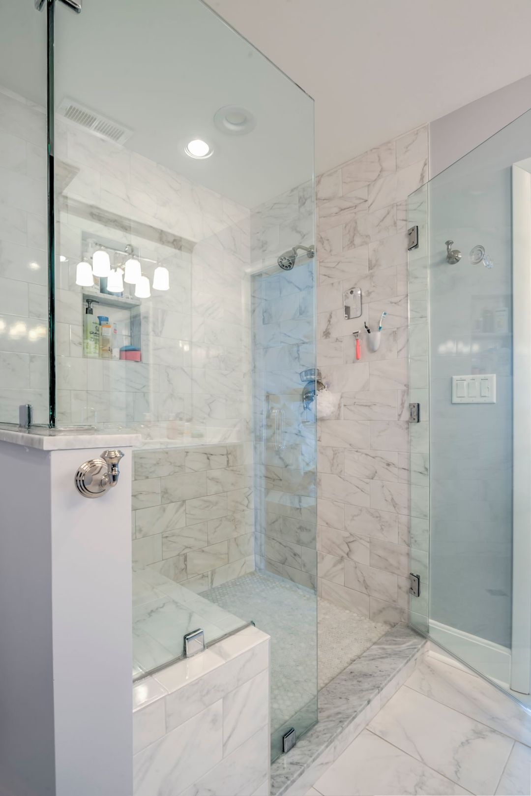 Bathroom Remodel in Kings Grant, Fenwick Island DE with Marble Floor and Shower Wall Tiles, and Frameless Shower Door