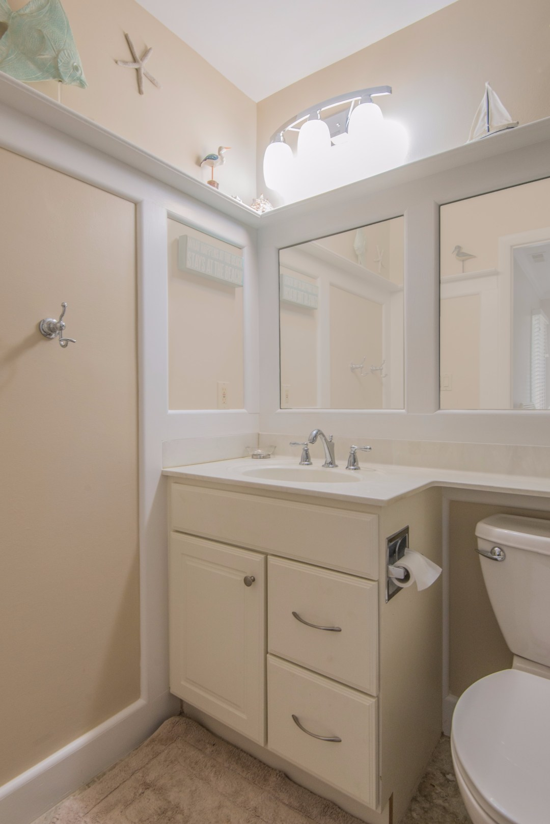 Bathroom Remodel in Kings Grant, Fenwick Island DE with Mantel Above Full Length Mirror and White Vanity With White Top