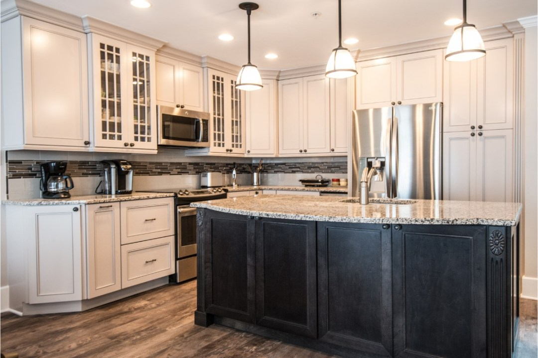 Traditional Kitchen Remodel in Kings Grant, Fenwick Island DE with Center Island Granite Countertop and White Glass Cabinets
