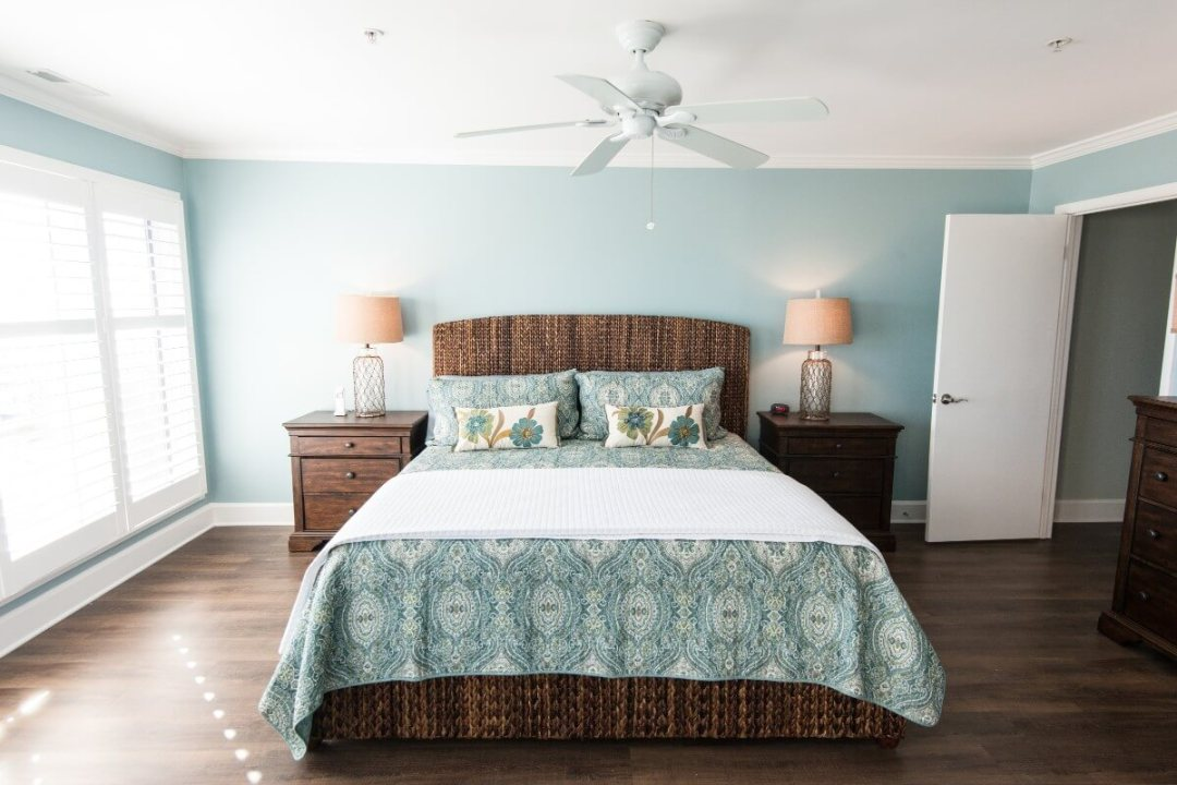 Kings Grant Renovation Vol.3 Fenwick Island, DE Light Sea Foam Painted Bedroom with Dark Wood Night Stands and White Ceiling Fan