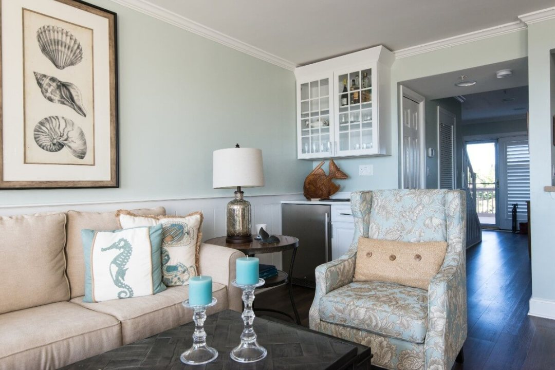 Kings Grant Renovation Vol.3 Fenwick Island, DE Living Room with Vintage Furniture, White Glass Cabinet and Sea Decor