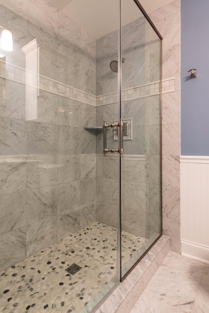Bathroom Remodel in Ocean Ridge, Bethany Beach DE with Glass Shower Door, Grey Marble Wall Tiles and Round Shower