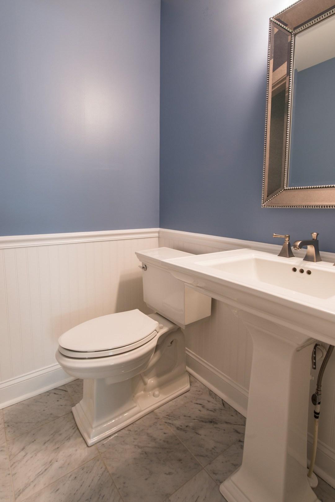 Bathroom Remodel in Ocean Ridge, Bethany Beach DE with Memoirs Pedestal Sink, Elongated Toilet and Framed Mirror