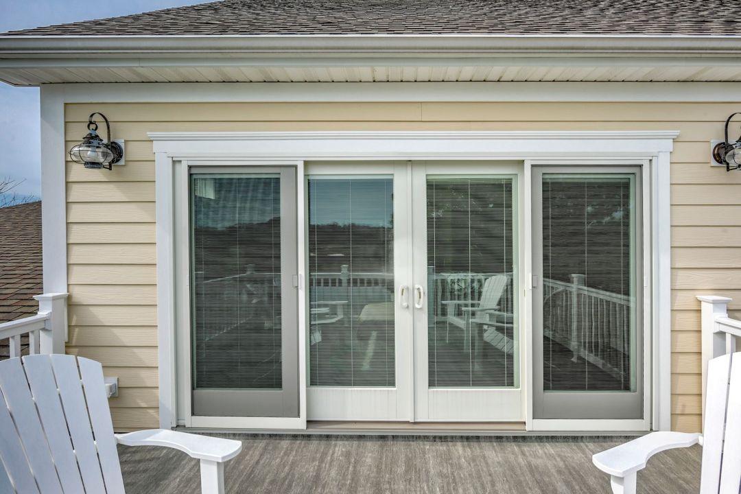October Glory Exterior in Ocean View DE - Sliding Screened Glass Doors on Upper Deck