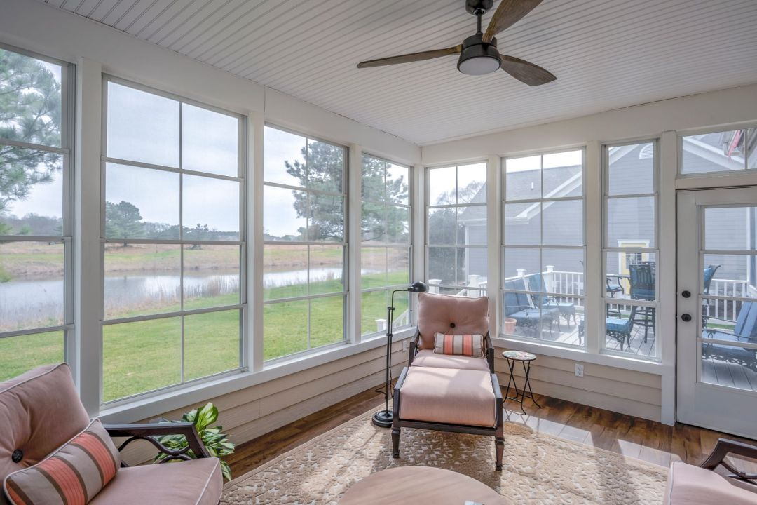 October Glory Exterior in Ocean View DE - Sunroom with View of Landscape and Lower Deck