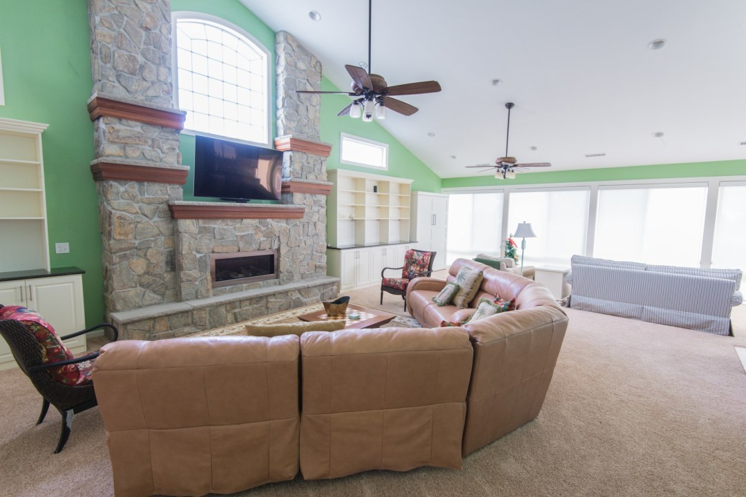October Glory Great Room Addition in Bear Trap Dunes, Ocean View DE with Large Sofa and Wall Mounted TV