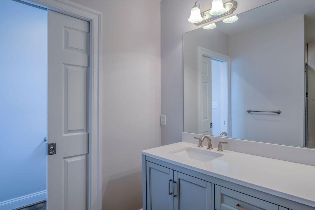 New Addition in October Glory, Ocean View DE - Bathroom with White Sliding Door