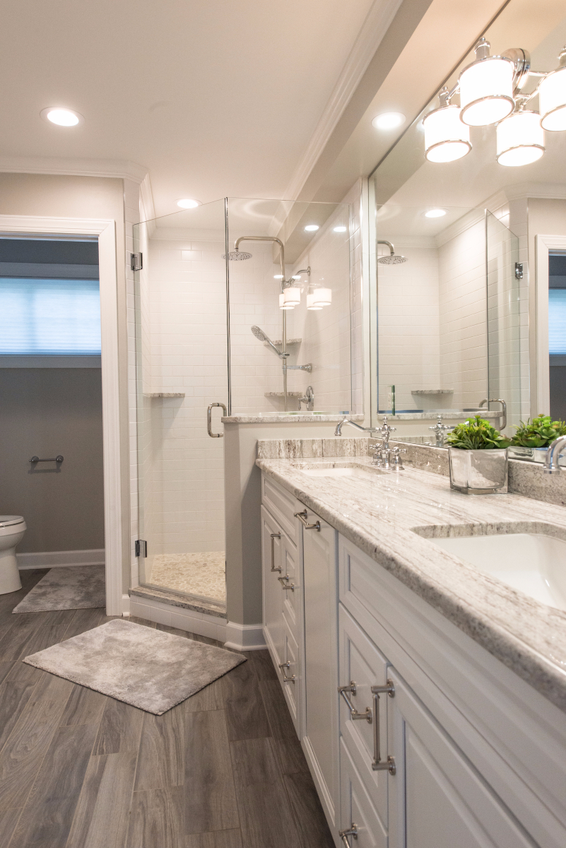 Bathroom Remodel in Pine Tree, Bethany Beach DE with Wood Floor, Frameless Glass Door, Shower Faucet, White Subway Wall Tiles