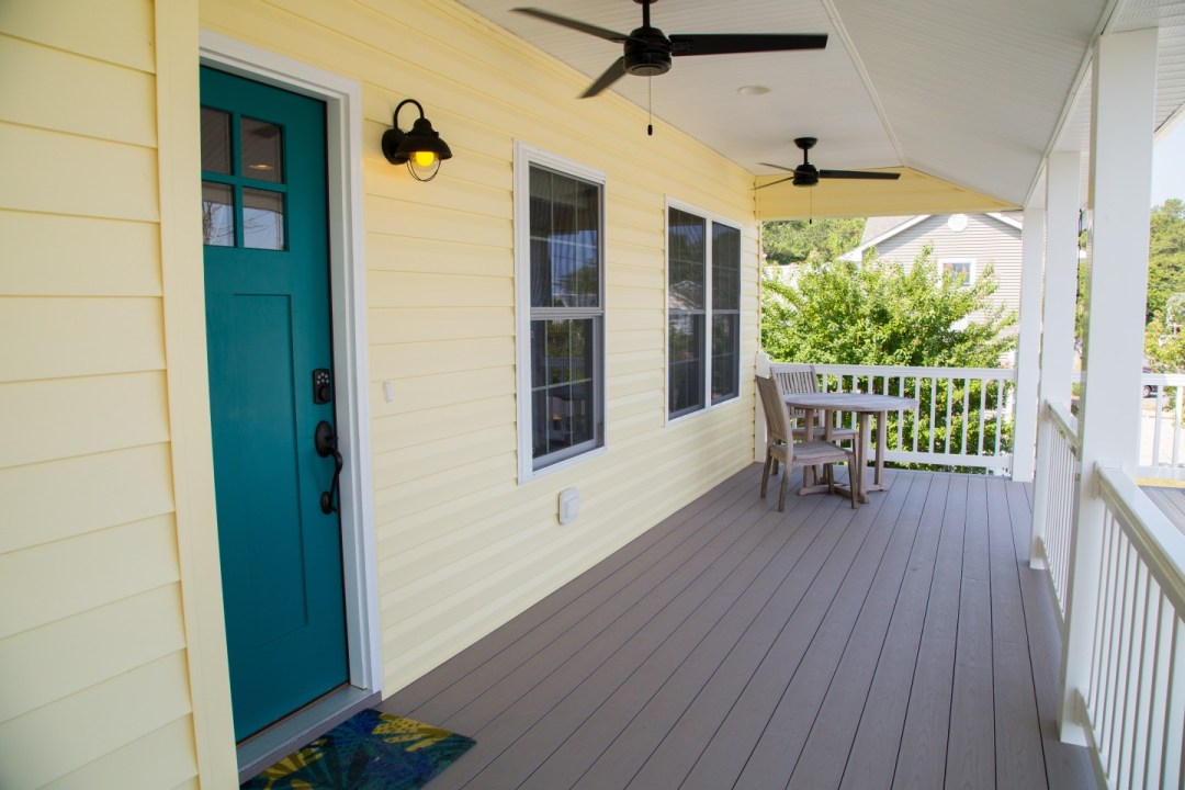 Porch with Main Entrance, Ceiling Fans and Beige Flooring