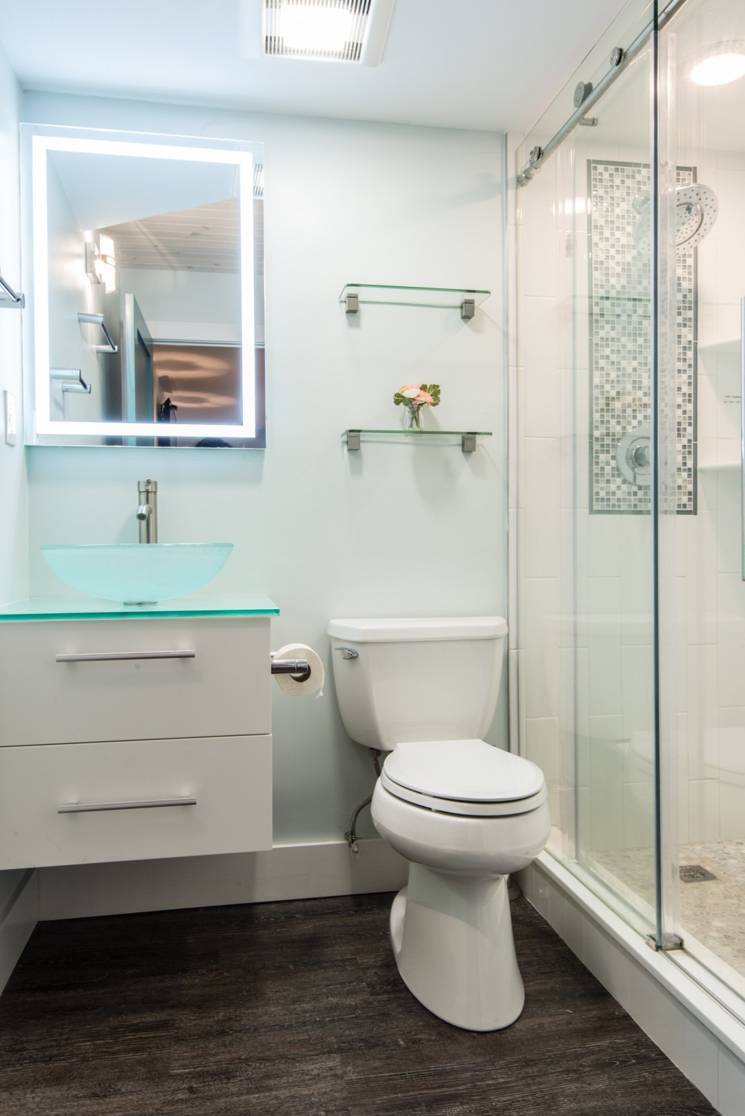 Bathroom Remodel in Sea Colony, Bethany Beach DE with Floating White Gloss Vanity Cabinet, Glass Vessel Sink, Backlit Mirror