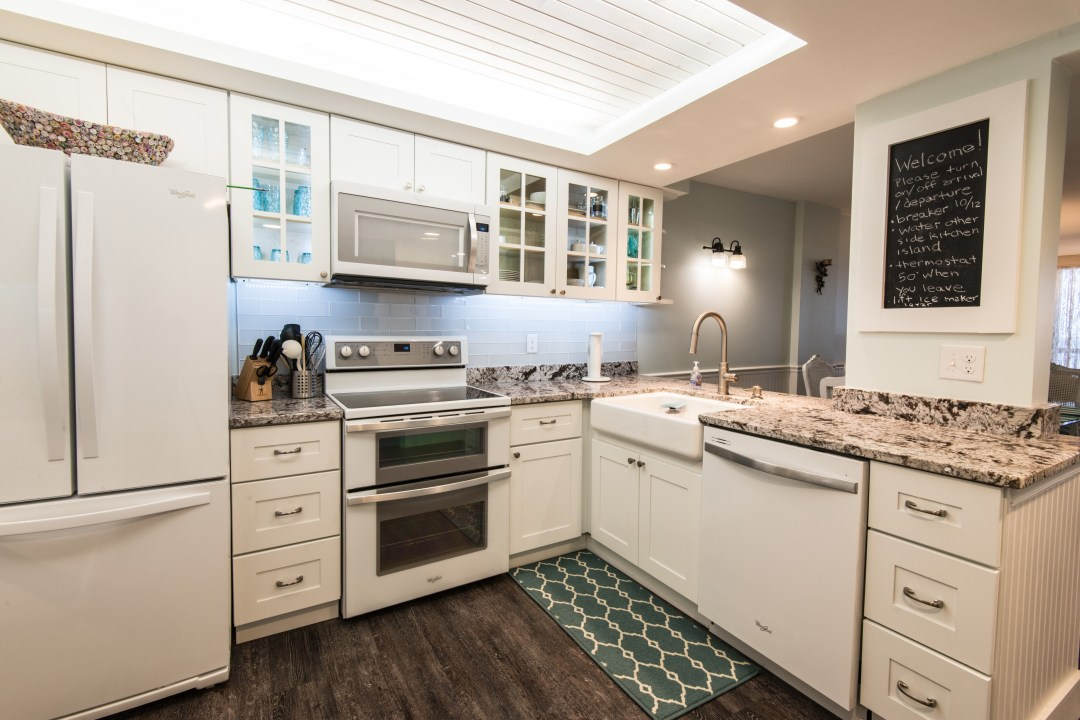 Kitchen Remodel in Sea Colony, Bethany Beach DE with White Cabinets, Custom Lights Ceiling, Farm Sink, Under Cabinet Lighting