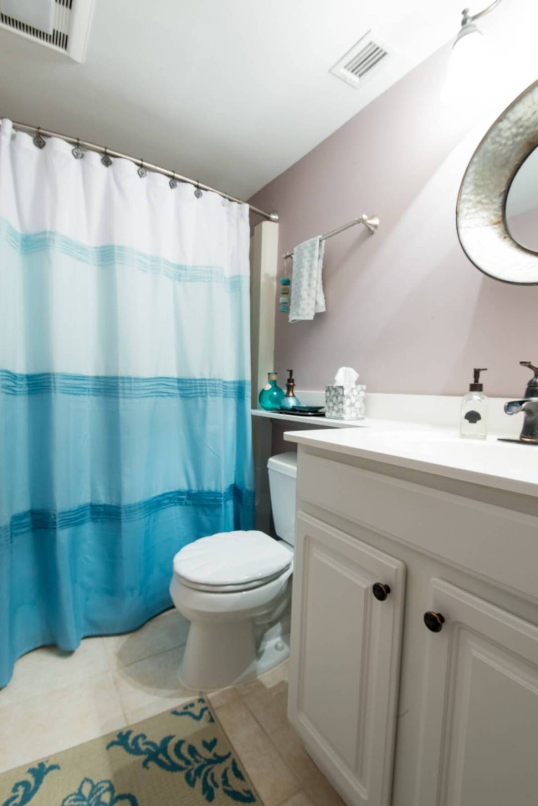 Sea Colony Condo Renovation Bethany Beach, DE Bathroom with Light Tile Floor, White Vanity Cabinet and Shower Curtain
