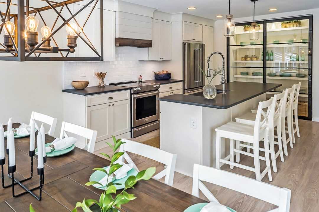 Contemporary Kitchen in Wellington Parkway, Bethany Beach DE with Dark Wood Dining Table and Vintage Lighting