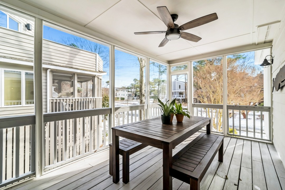 Four Season Porch with Wooden Table, Bench Seats and Ceiling Fan in Wellington Parkway, Bethany Beach DE Renovation