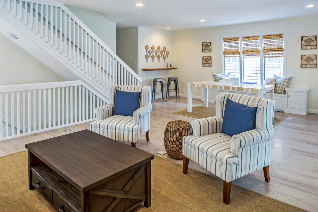 Family Room with Dark Wood Table and Two Armchairs in Wellington Parkway, Bethany Beach DE Renovation
