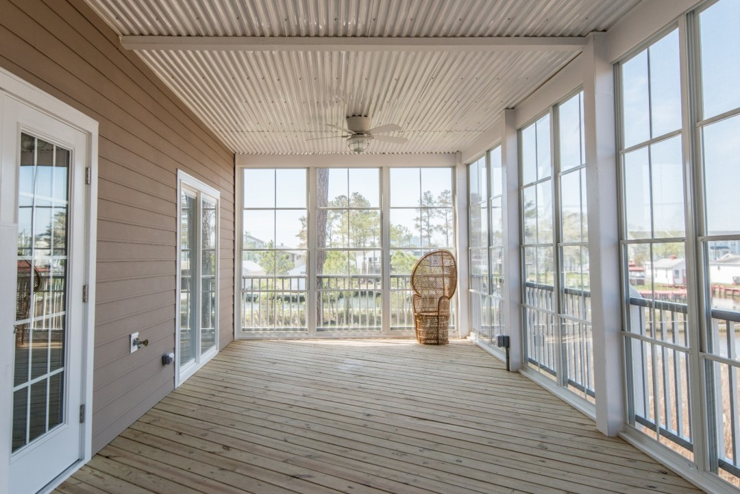 Whitesview Court Sunroom in Ocean View DE Four Season Sunroom with Storm Door and Ceiling Fan