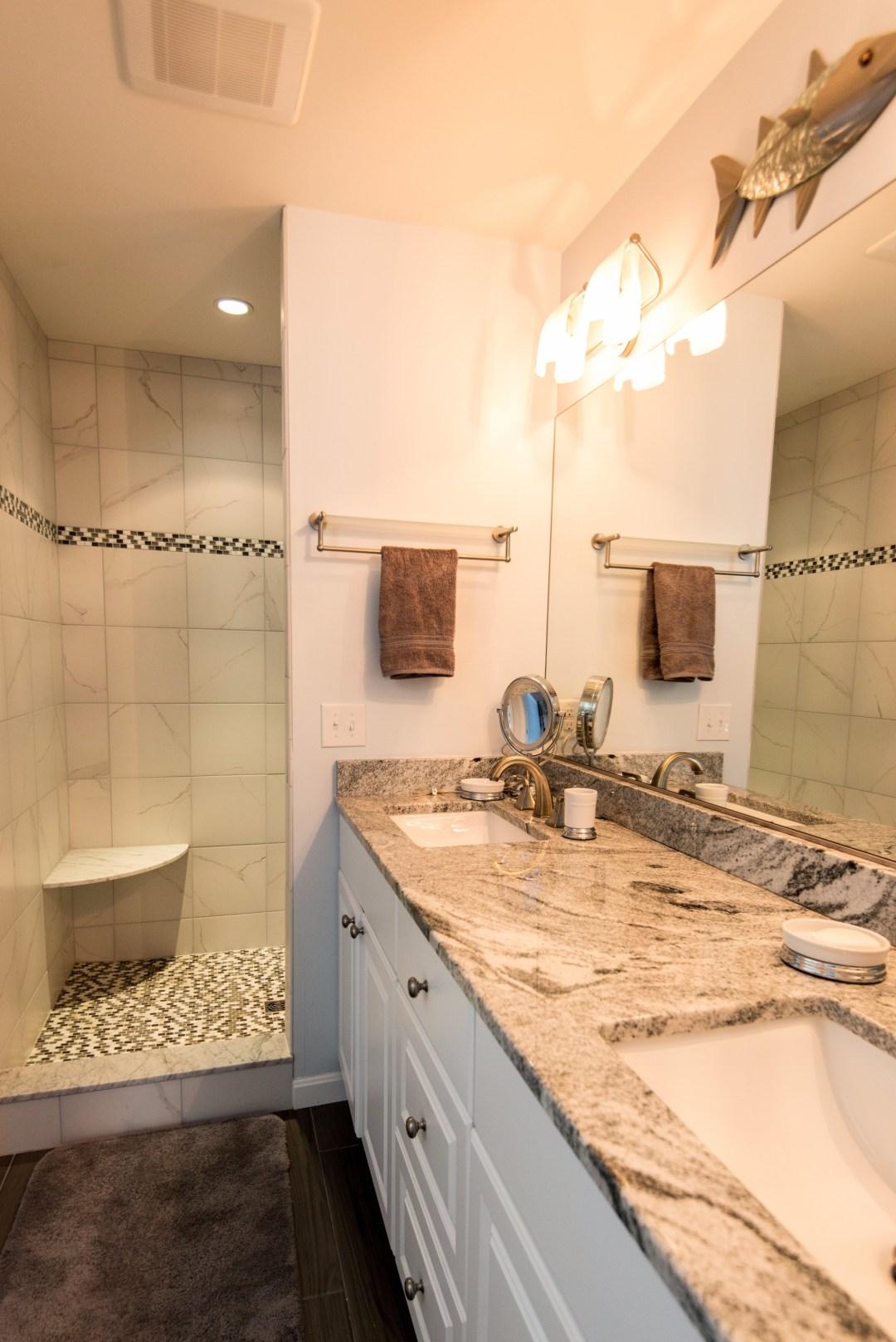Bathroom Remodel in Willow Oak, Ocean View DE with Dark Wood Floor, Double Bowl, White Vanity Cabinet and Full Length Mirror