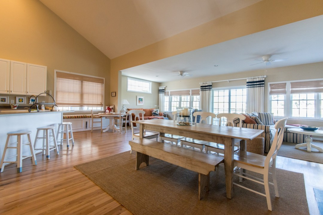 Willow Oak New Addition in Bear Trap Dunes, Ocean View DE Extended Family Room Dining Room Area with Wood Table and Hardwood Flooring