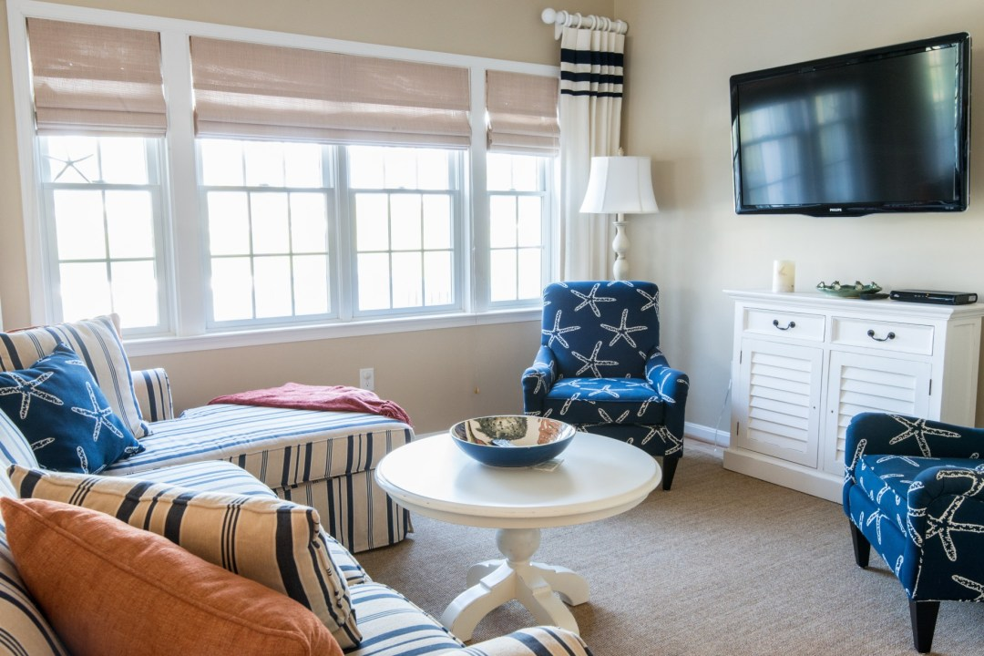 Willow Oak New Addition in Bear Trap Dunes, Ocean View DE Family Room with Wall Mounted TV, Sofa, Large Windows, Hardwood, Carpet