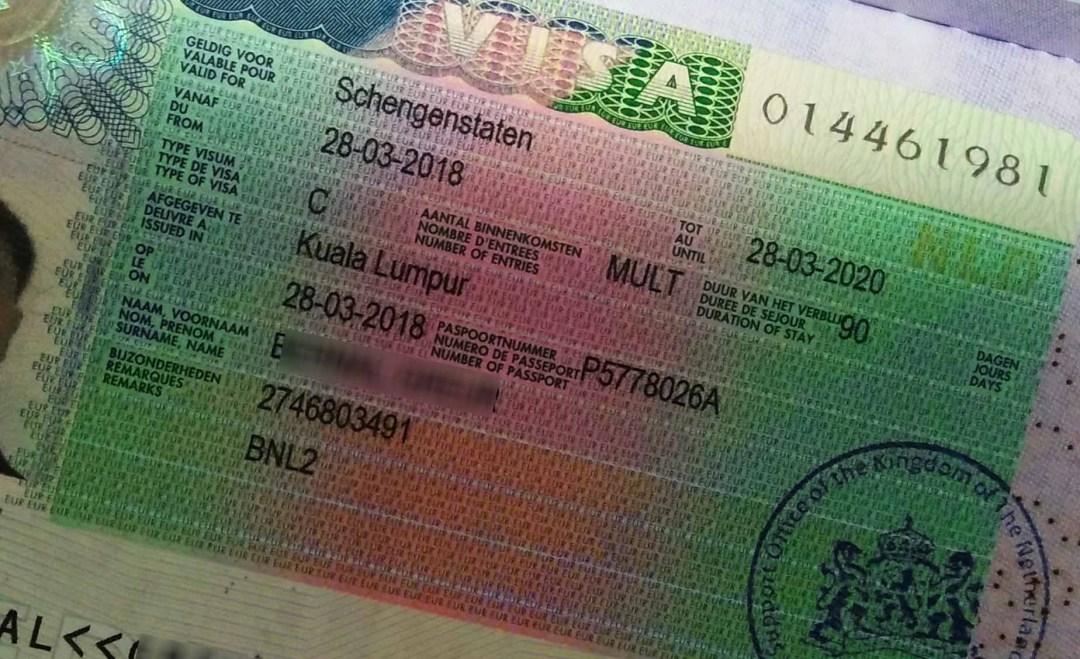 Image of a Schengen Visa attached to a passport