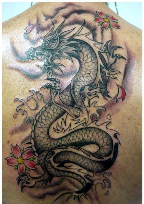 A Sailor's dragon tattoo on his back.