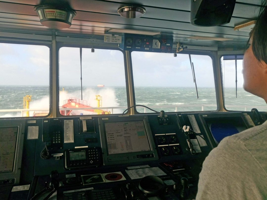 Helmsman on a very rough weather.
