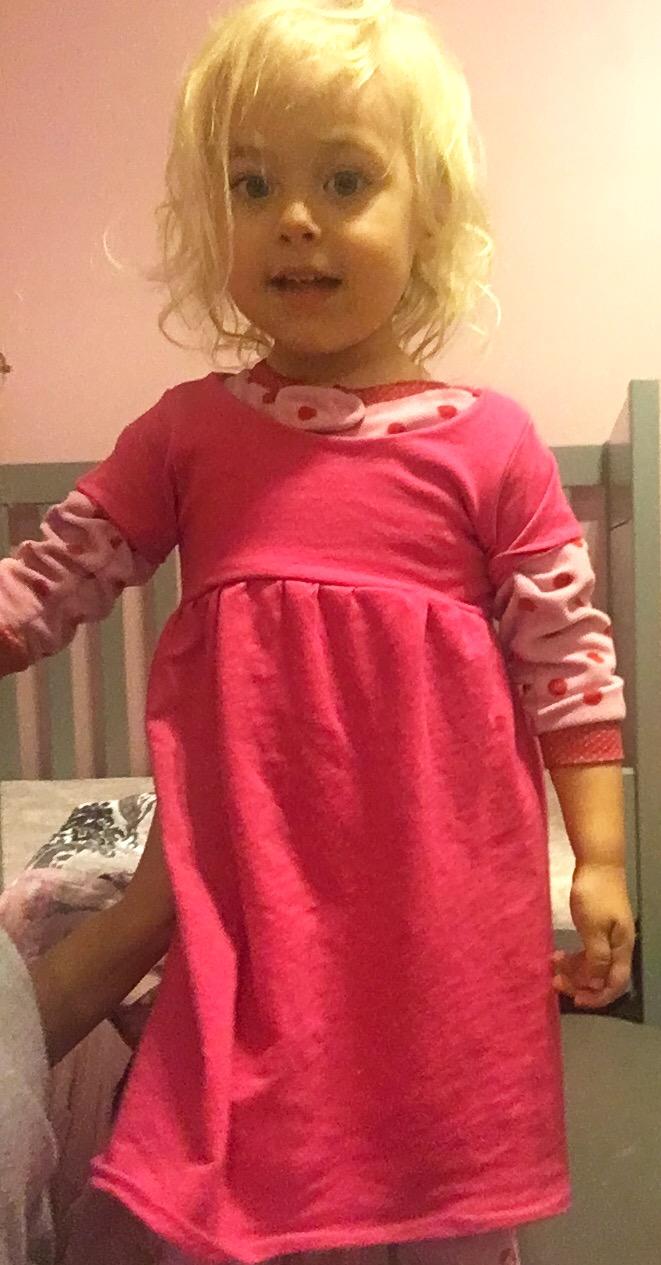 Baby Girl Sleeping with a dress over her pajamas
