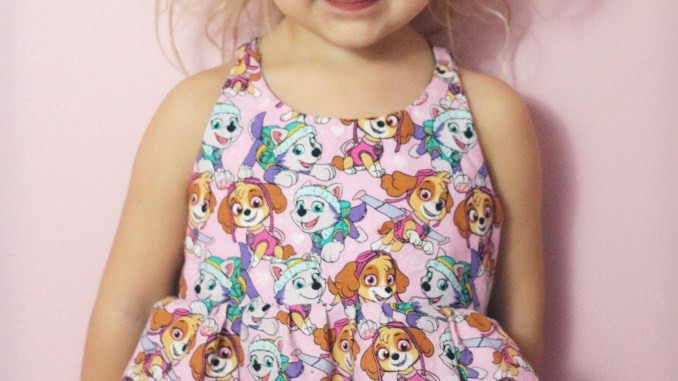 Petite Stitchery Periwinkle sewing pattern girls woven tunic in pink paw patrol skye and everest fabric 2