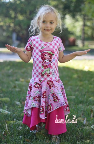 Petite Stitchery Girls Daisy Dress Sewing Pattern with lengthened bodice in Strawberry Shortcake Inspired Fabric.