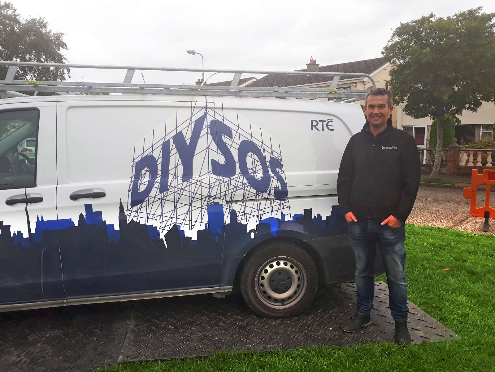 Pictured is Brian Devane from Sean Doyle & Sons Ltd on set at the DIY SOS filming. The Roscommon company assisted with the extension to the house in County Kildare by providing grey Aluminium double glazed windows for the project.