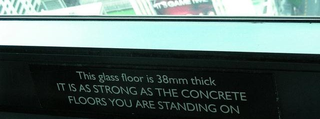 Sign: this glass floor is 38mm thick - it is as strong as the concrete floors you are standing on