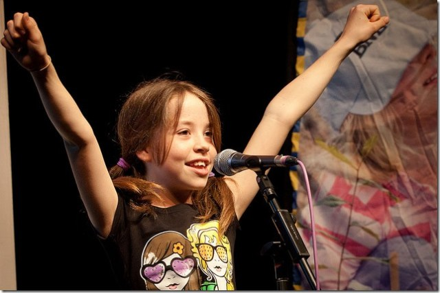 Girl as triumphant public speaker