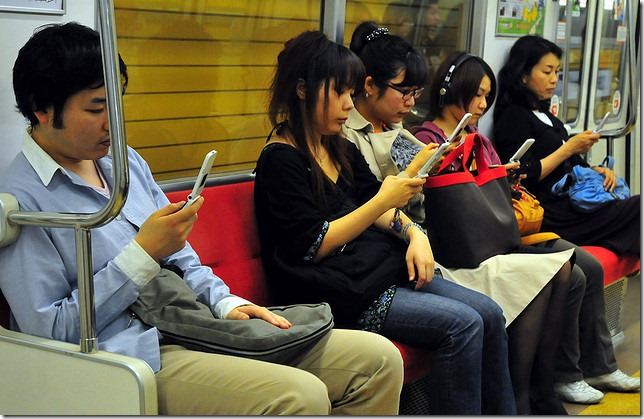 People using mobiles