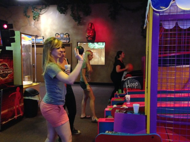 Alison mastering skee-ball.