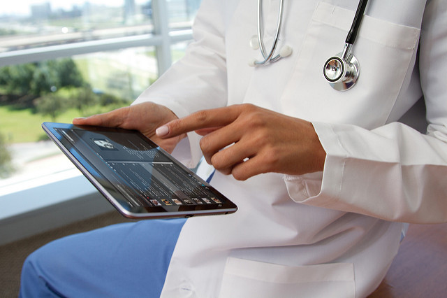 Image of doctor using a tablet - Search Influence