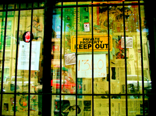 Door with bars and keep out sign - Search Influence
